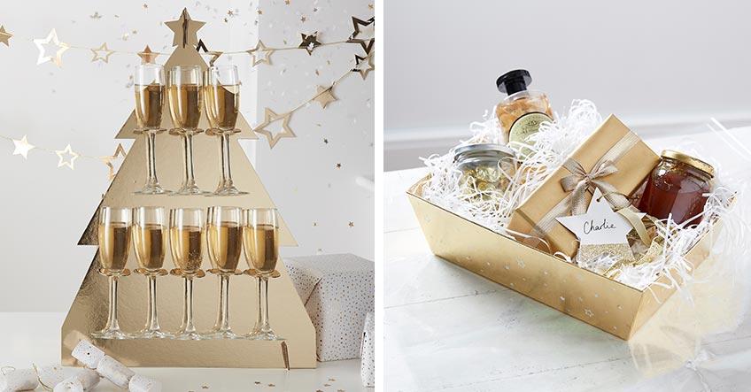 Champagner in goldenem Halter und glänzende Geschenkverpackung für edle Weihnachten