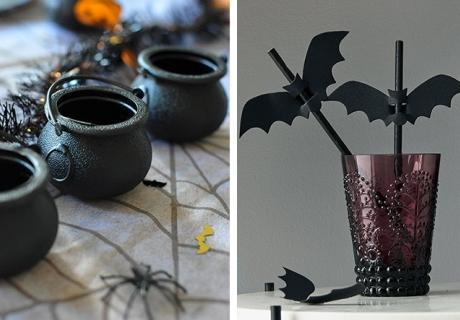 Verwende in der Tischdeko elegante Halloween-Motive wie Hexenkessel und Fledermäuse